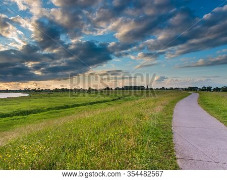 Cycling Track On The River Dike Of The Ijssel In The Netherlands