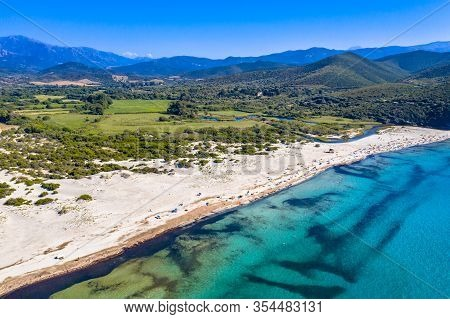 View Over Ostriconi Beach On North East Coast Of Corsica Island Near Ile Rousse, Calvi, France