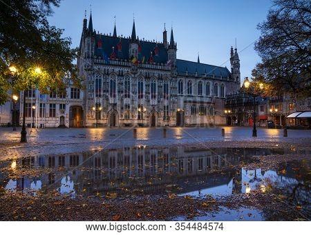 Bruges, Belgium - November 2, 2019: Panoramic Image Of The Historic Townhall At Daybreak, Historic B