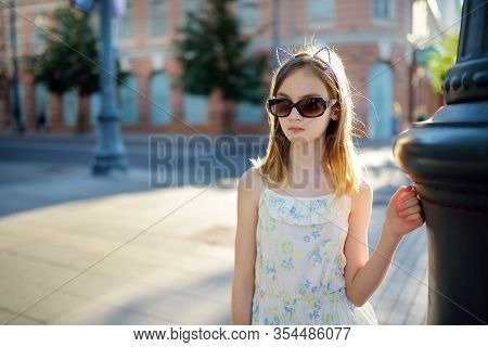 Cute Young Girl Sightseeing On The Streets Of Vilnius, Lithuania On Warm And Sunny Summer Day. Famil