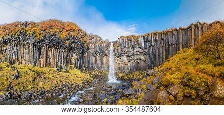 Svartifoss Waterfall Panorama Of Black Basalt Columns Between Autumn Colored Landscape