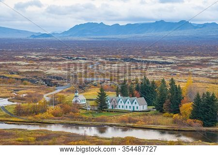 Thingvellir National Park In Iceland Church And Wooden Houses In Front Of Epic Landscape