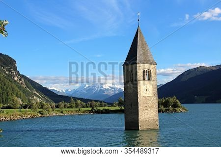 A View Of The Enchanting Lake Resia In The Friuli Alps In Italy