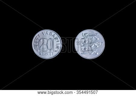 An Old Estonian Coin Isolated On Black, 20 Senti 1998 Year. Coinage, Close-up.