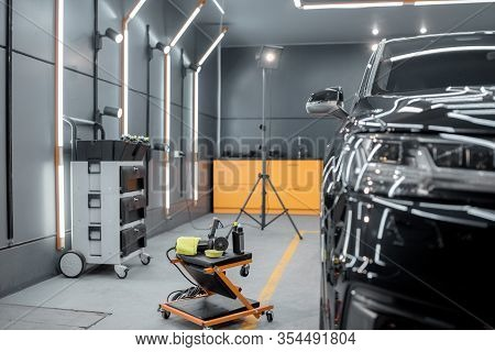 Car Service Station With Luxury Car Prepared For The Body Polishing. Concept Of Car Detailing And Ca