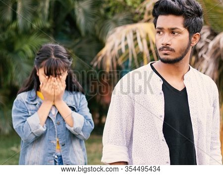 Concept Of Teenager Couple Love Breakup - The Angry Serious Boyfriend Leaves His Sad Girlfriend Behi