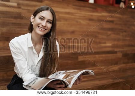 Powerful Woman And Business Concept. Alluring Young Caucasian Girl Sitting On Stairs, Having Lunch B