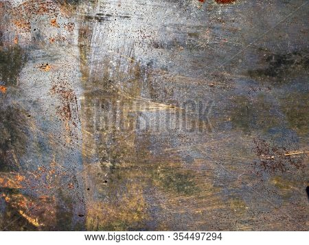 Rusty Silver Metal Texture. Gray, Purple And Orange. Grunge Texture Of A Garage Wall. Scratched Meta