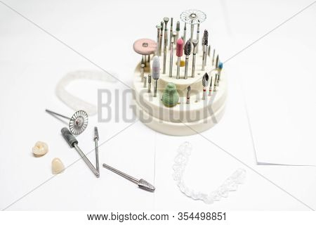 Set Of Dental Technician Burs And Working Instruments For Implants And Gypsum Jaws Manufacturing On