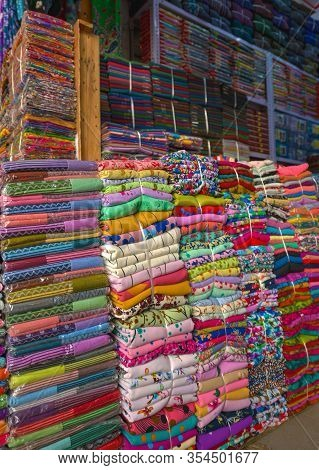 Stacks Of Colorful Fabrics For Sale In The Wear-house