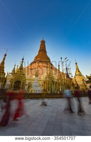 Shwedagon Pagoda Devotees Walks In Front Of Main Golden Stupa
