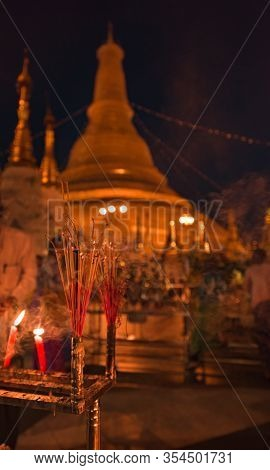 Shwedagon Pagoda Incents And Candles Burning In Front Of Golden Stupa Yangon Myanmar