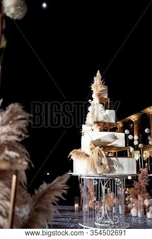 Unusual Square White Tiered Wedding Cake. A Traditional Treat For The Feast Of The Bride And Groom.