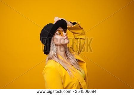 Stylish Trending Young Woman In Bright Clothes On Yellow Background, Copy Space. Cool Blonde Girl In