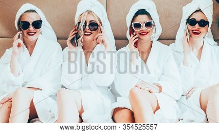 Hen Party. Spa Therapy Leisure. Happy Posh Women In Bathrobes Sunglasses Talking On Phones.
