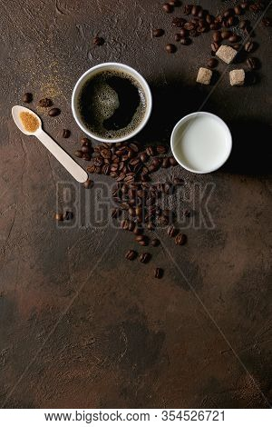 Paper Cups Of Americano Coffee And Milk, Recycled Wooden Spoon Of Cane Sugar, Coffee Beans Over Dark