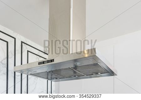 Modern Stainless Steel And Range Hood In The Kitchen Interior. Stainless Steel Cooker Hood With Ligh