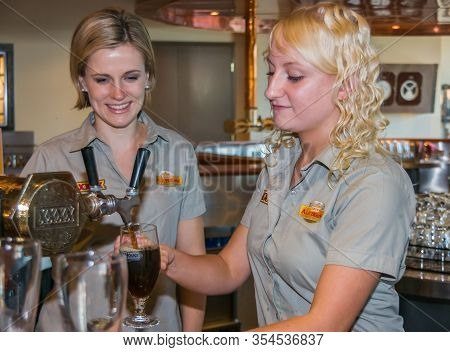 Brisbane, Australia - December 8, 2009: Castlemaine Perkins Brewery. 2 Young Women Bar Servants Tapp