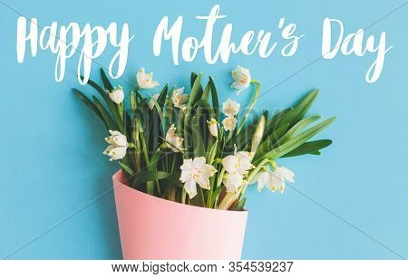Happy Mother's Day Text On White Spring Flowers In Pink Bouquet On Blue Background. Stylish Floral C