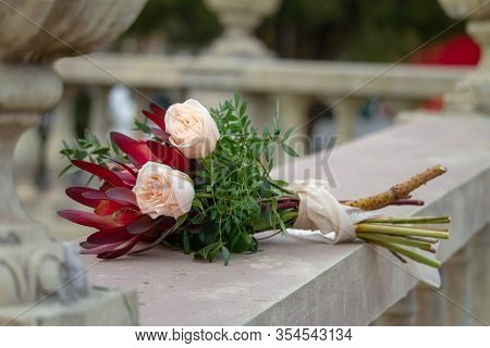 Beautiful Vintage Bouquet On A Balustrade Or Stone Railing In A Public Park, Greeting Concept