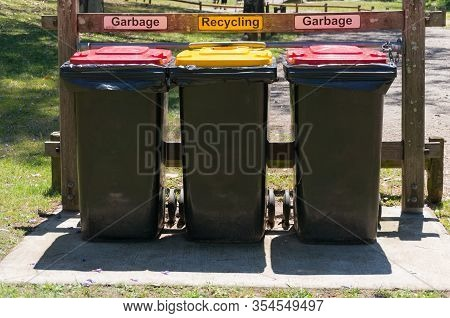 Sydney, Australia - November 12, 2016: Three Rubbish Bins In The Park. Landfill And Recycling Rubbis