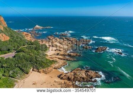 Seascape With Picturesque Coastline With Beach And Waves. Pristine Tropical Beach Nature Background.