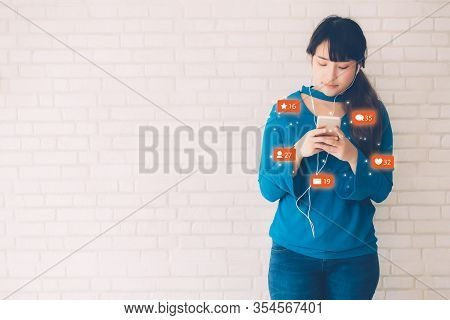 Beautiful Young Asian Woman Using Smart Mobile Phone Looking And Social Media Online, Asia Girl Havi