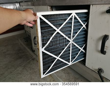 Soft Focus To Filter Of Air Handing Unit, Technician Checking A Pre-filter Of Air Handling Unit For
