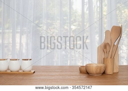 Wooden Kitchenware On Kitchen Table, View From Front Table.