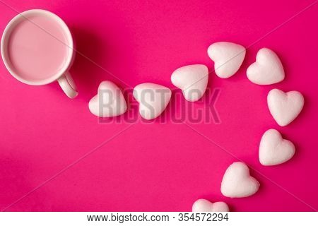 Cup Of Strawberry Milk With Heart Shape Symbol On Pink Background, View From Above Table.