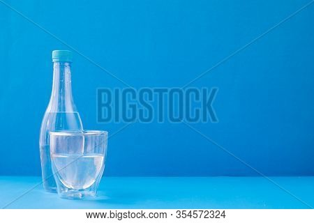 Glasses Of Water On Blue Background, View From Front Table.
