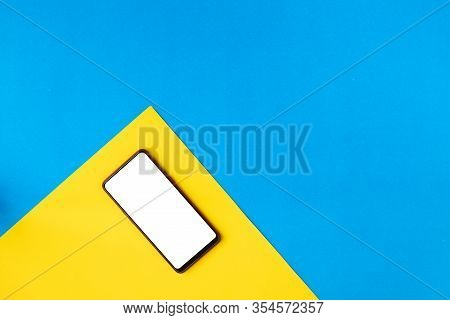 Flat Lay Mockup Smartphone On Yellow Background, View From Above Table.