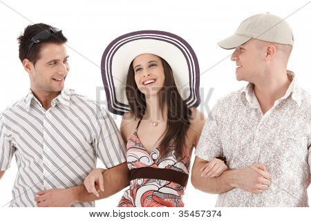 Summer portrait of attractive people, pretty woman in straw hat arm in arm with handsome men, laughing, isolated on white.