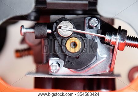 Elements Of The Fuel System Of A Gasoline Trimmer. Fuel Tank And Carburetor Trimmer Engine. Fuel Sys