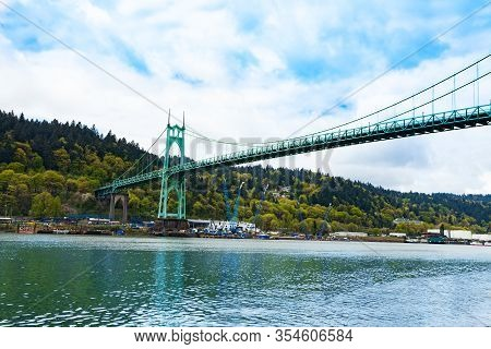 Willamette River View And St. Johns Bridge In Portland The Steel Suspension Construction, Oregon, Us
