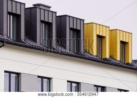 Facade Of Windows In Attic Or Loft Housing Or Office. Apartments Under The Roof In A Modern House Or