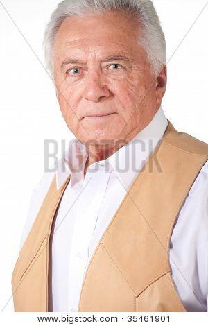 Senior Man In Brown Leather Vest