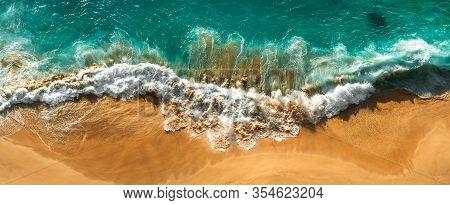 Aerial View Of Turquoise Ocean Waves In Kelingking Beach, Nusa Penida Island In Bali, Indonesia. Bea