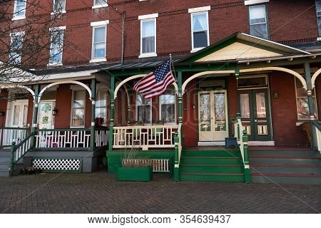 Burlington, New Jersey - March 4: Historic Row Homes With Wooden Porches On March 4 2020 In Burlingt