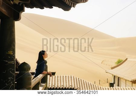 Single Young Asian Girl Enjoy The Beautiful Desert View On Old Tower At Mingsha Mountain And Crescen