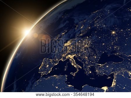 Planet Earth At Night, View Of City Lights Showing Human Activity In Europe And Middle East From Spa