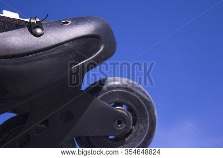 Black Freestyle Roller Skates. No People. Blue Sky