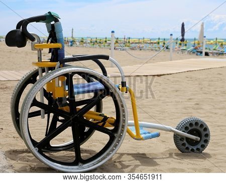 Special Wheelchair With Aluminum Wheels To Move On The Sand Of The Beach