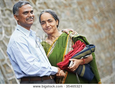 Happy Smiling indian adult people couple outdoors