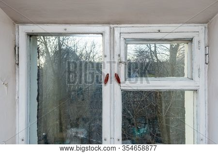 An Old Vintage Wooden Window With Peeling Paint Oh Frames Needed To Be Repaired Or Replaced.