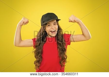 Girl Long Curly Hair Wear Cap. Must Have Street Style Accessory Trends. Modern Fashion. Kids Fashion