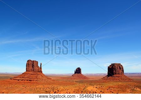The West And East Mitten Buttes Form A Triangle With Merrick Butte In The Monument Valley Navajo Tri
