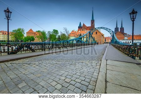 Fantastic Cobblestone Road On The Tumski Bridge And Cathedral Of The St John The Baptist In Backgrou