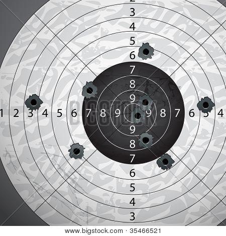 Gun bullet`s holes on paper target