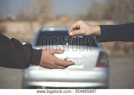 The Car Salesman And The Key To The New Owner